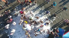 Foam party shooting 120 frames from the air Stock Footage