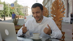 Happy Businessman in the cafe on the skype videoconference. Online work Stock Footage