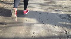 Legs of the athlete run a camera follows them Stock Footage