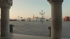 Parking gandolas on the Doge's palace embankment with the bell tower of the Stock Footage