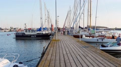 Time-lapse of people walking on a sail boat dock, in Hanko, Finland Stock Footage