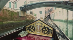 Riding on gondola on a narrow canals of Venice, Italy Stock Footage