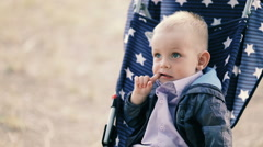 Little boy sitting in baby carriage Stock Footage