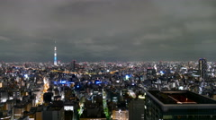 Elevated motion timelapse of citylights and night clouds over the Tokyo sky. Stock Footage
