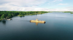 Aerial Shot of Ferry with Cars and People Crossing forest River - stock footage