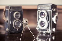 Vintage photo cameras collector desktop Stock Photos