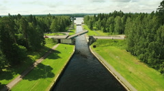 Aerial Shot of Movable Bridge Surrounded by Forest - stock footage