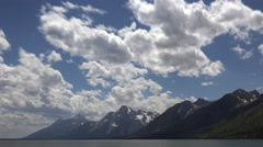 4K Clouds Sweep Across Grand Teton Mountains In Summer Stock Footage