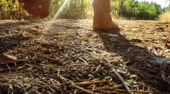 SLOW MOTON: Young man walking through the forest Stock Footage