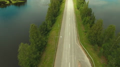 Aerial Shot Over Road Surrounded by Water Stock Footage