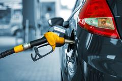 Car refueling on a petrol station - stock photo