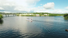 Aerial Shot of Boat with Passengers Floating on River in Sunny Day. Stock Footage