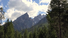Blue Sky Clouds Sweep Across Grand Teton Mountain Peaks Colorado Time Lapse Stock Footage