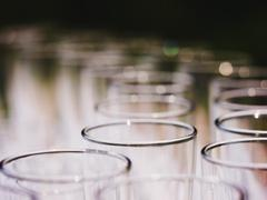 Empty glasses on a banquet table close up - stock photo