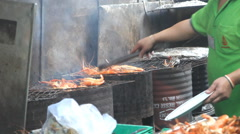 Chef grilling food in restaurant in Bangkok, Thailand Stock Footage