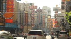 Traffic on Yaowarat Road  Chinatown district in Bangkok, Thailand. Stock Footage