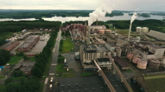 Aerial Shot of Chemical Plant Surrounded by Large Pine Forest Stock Footage