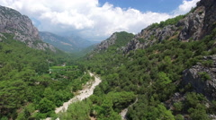Flying Between Mountains.4K Clip captured by drone cam Stock Footage