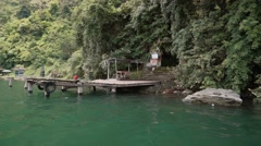 View from a boat departing from Trunyan cemetery entrance on shore, Bali Stock Footage