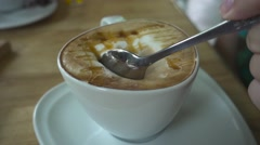 Female's Hand Scoop Cappuccino's Foam by Teaspoon in a Cafe. Slow Motion Stock Footage
