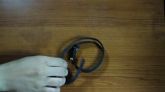 Putting On The Leather Bracelet On The Hand Stock Footage