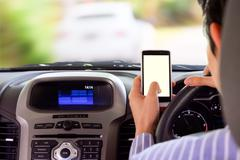 Driving while holding a mobile phone cell phone use while driving Kuvituskuvat