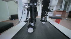 Man with innovative robotic VR cybernetic system walking like a robot. Hi-tech Stock Footage