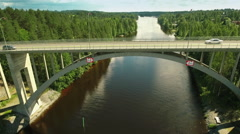 Aerial Shot of Tall Bridge Over Large Forest River at Bright Sunny Day Stock Footage