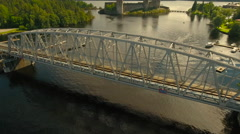 Aerial Shot of Iron Bridge Over Forest River Stock Footage