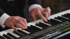 Hands of man, playing synthesizer Stock Footage