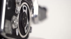 Vintage Bolex 8mm film camera rotating closeup against white bg (loopable) Stock Footage