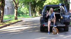 Beautiful female smilling style portrait sit car american bulldog Stock Footage