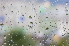 Abstract rain drops on the window glass Kuvituskuvat