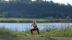 Athlete yping female squats outdoors Stock Footage