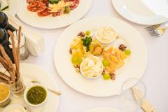 Festive table served with appetizing different food Stock Photos