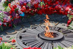Flowers on Monument with Eternal fire to the unknown soldier. Kiev, Ukraine Stock Photos