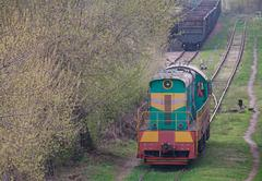 Shunting diesel locomotive standing on the siding. Transport Stock Photos