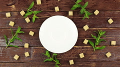 A man puts a cup of tea on table with fresh mint leaves and brown sugar in cubes Stock Footage