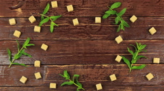 A man puts a cup of tea on table with fresh mint leaves and brown sugar in cubes - stock footage