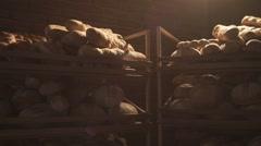 Bread on a Wooden Shelfs in the Sun Light - stock footage