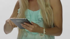 Beautiful Blonde Female Model close up tablet use - stock footage