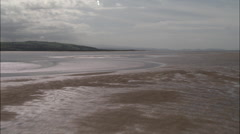 Low Over Dee Estuary Towards Point Of Ayr Lighthouse Stock Footage