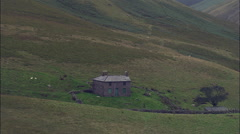 Pull Out From Isolated Cottage Near Burnmoor Tarn Stock Footage