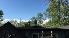 Family Having Water Ballon Fight On House Roof Stock Footage
