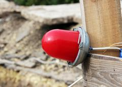 Red warning light which enclosing the ditch, where the repair of water pipes - stock photo