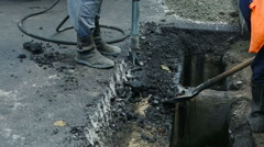 Road Paving. Workers laying stone mastic asphalt during street repairing work Stock Footage