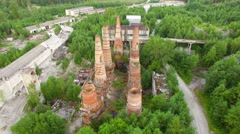 Ruins of old factory with high chimney Stock Footage