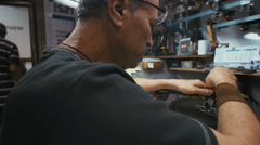 RAMAT GAN, ISRAEL, JULY 21 2016. A diamond polisher polishing a diamond Stock Footage