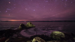 Starry night over the island Olkhon. Burkhan Cape, Olkhon island, Lake Baikal,  Stock Footage