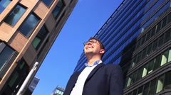 Portrait of an handsome businessman in an urban setting Stock Footage